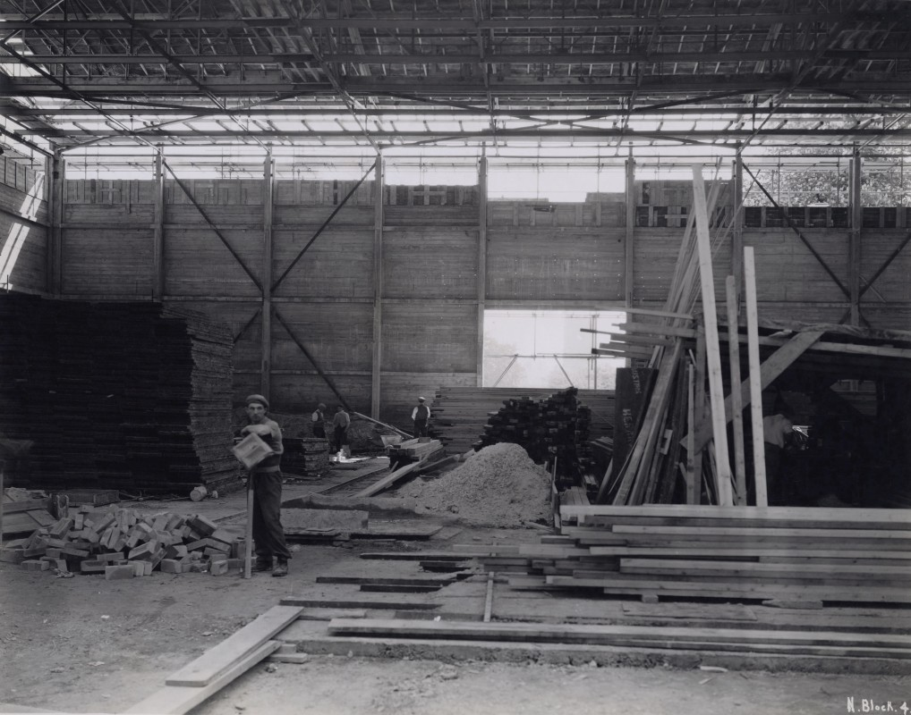 Black and white photograph of figure in a half built room