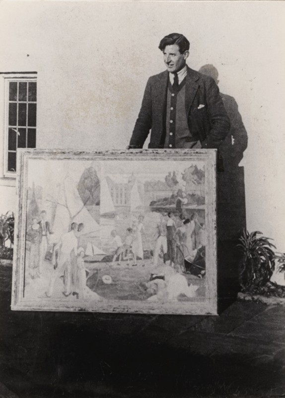 Humphrey Waterfield standing outside, with large framed painting resting on ground