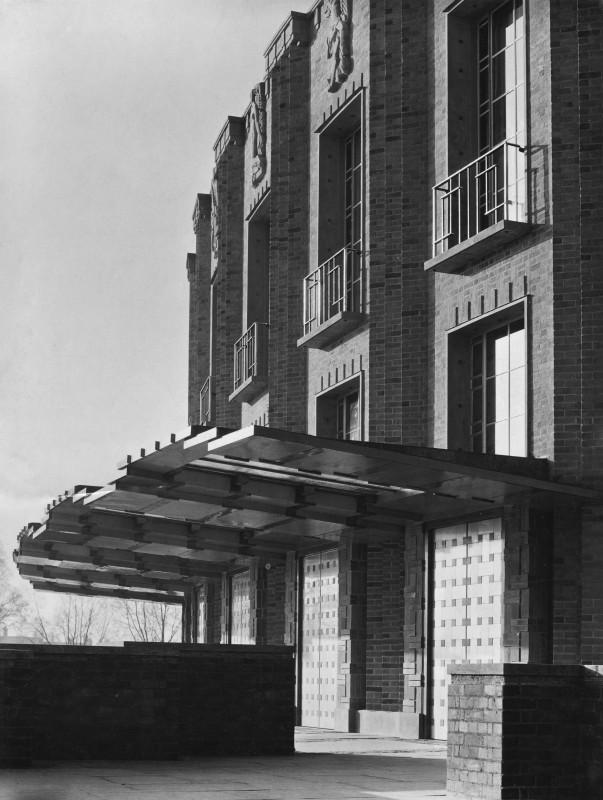 Black and white photograph of a brick building with canopy