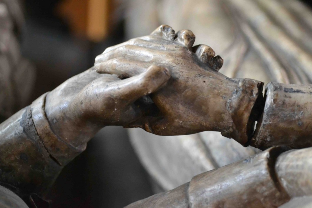 Detail of sculpted clasped hands