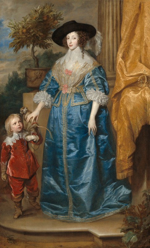 Woman in long blue dress with wide brimmed hat with a child in red
