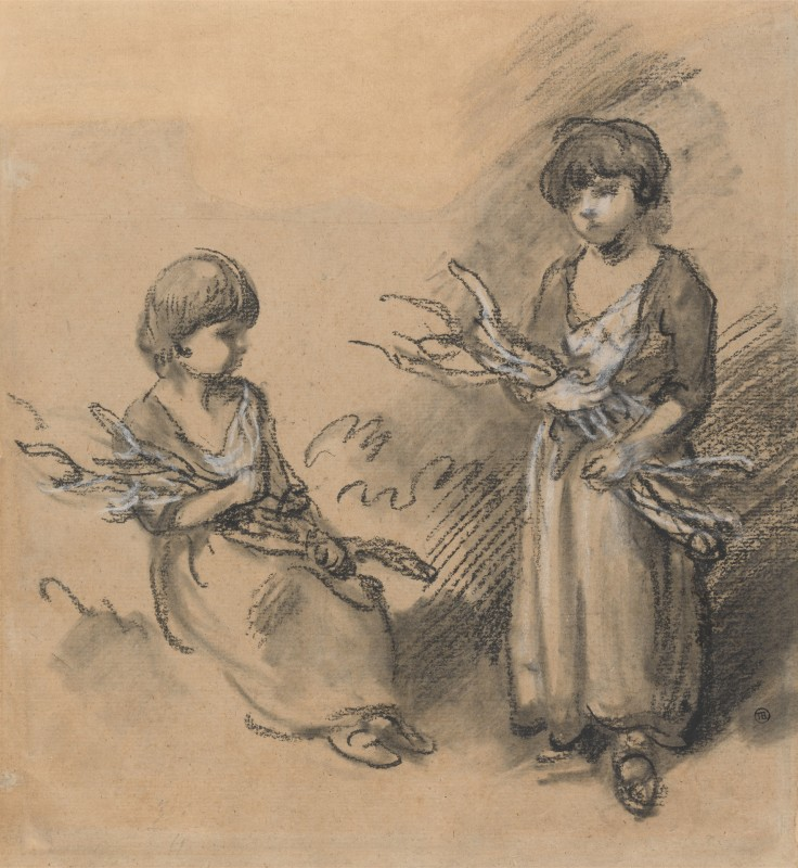 Two children carrying bundles of sticks