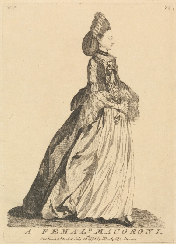 Woman in long dress standing profile