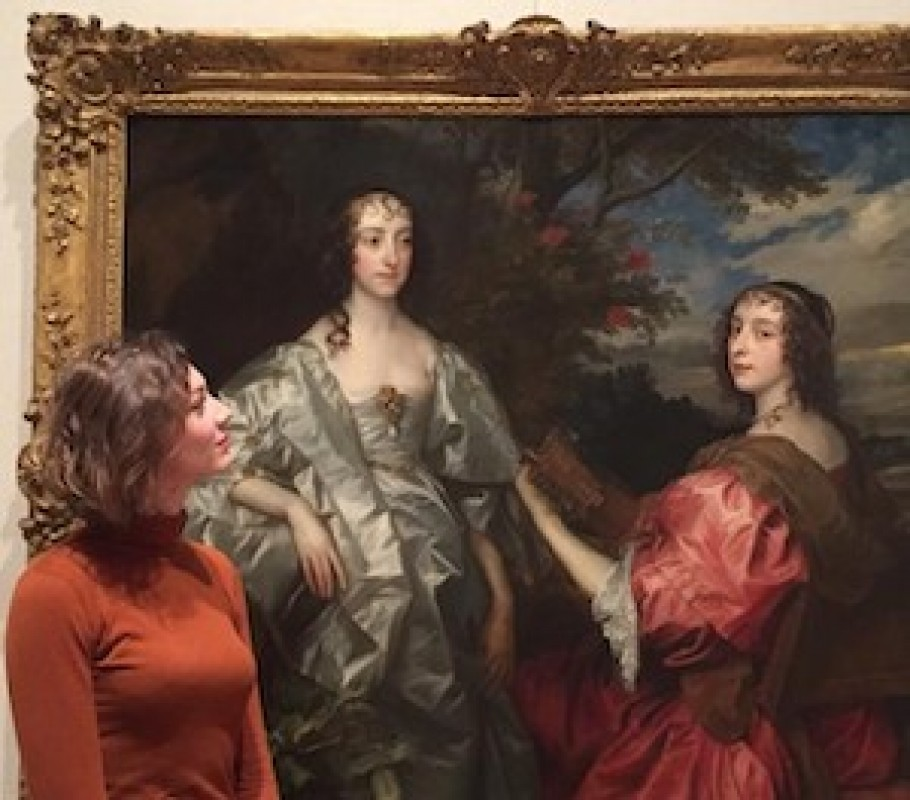 Side-on portrait of Emily Burns looking at a painting.
